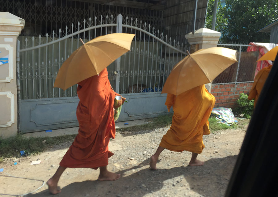 Monks collect alms on the street